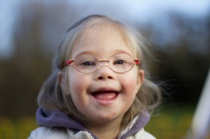A Young Girl With Down Syndrome Wearing Eyeglasses